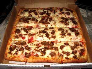 Pizza in the Finger Lakes region has thick crust and is cut into squares.