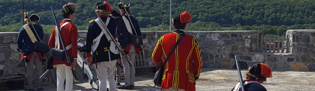 Fort Ticonderoga soldiers reenacting loading a cannon