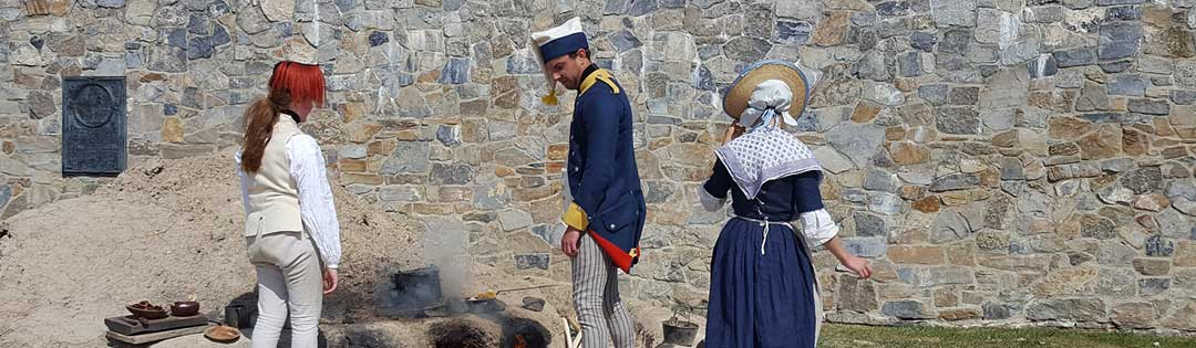 People dressed in 1750s clothes reenacting at Fort Ticonderoga