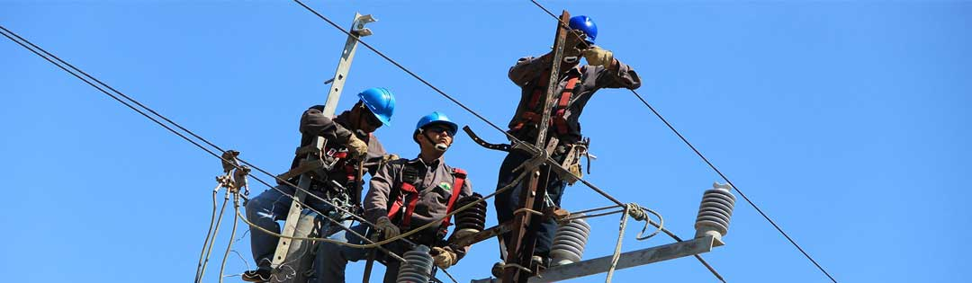 workers on a utility pole