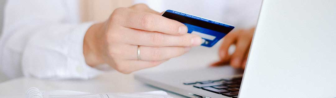 Woman paying online by credit card